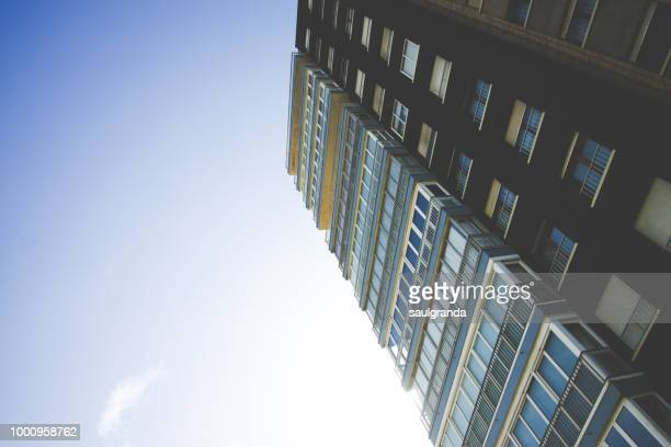 Apartments block against blue sky, low angle view