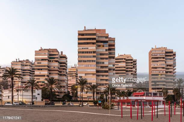 apartments complex by the the beach in torremolinos - dorte fjalland stock pictures, royalty-free photos & images