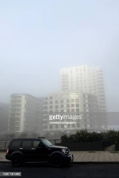 apartments in the mist - stevebphotography stock pictures, royalty-free photos & images
