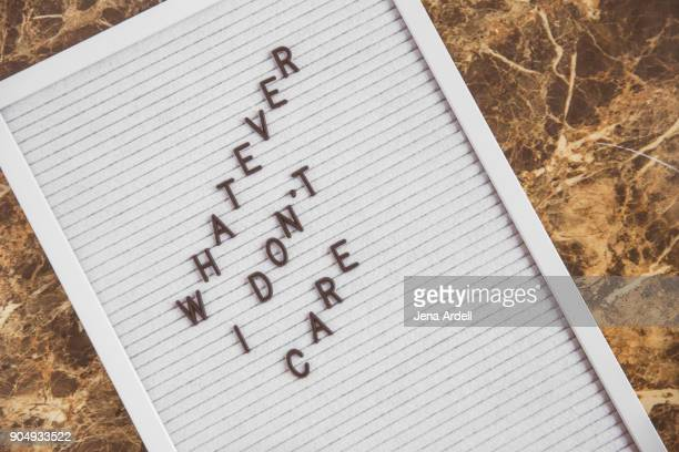 apathetic letter board phrase whatever don't care - typographies stock photos and pictures