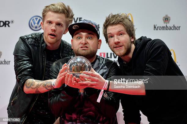 'ApeCrime' pose with the award during the 1Live Krone 2014 at Jahrhunderthalle on December 4 2014 in Bochum Germany