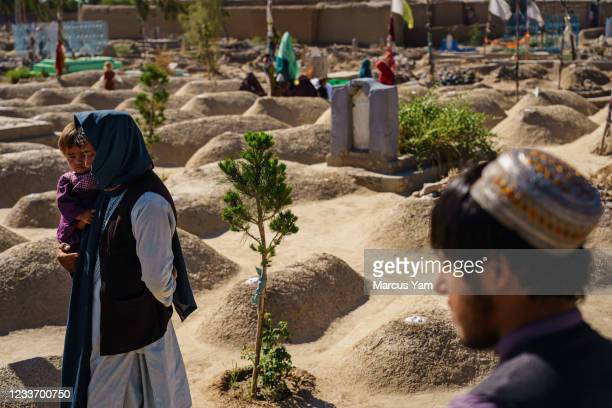 APeople pray over the Arab shrine, dedicated to the scores of Arab Al Qaeda fighters and their families, all killed in the waning days of 2001 when...