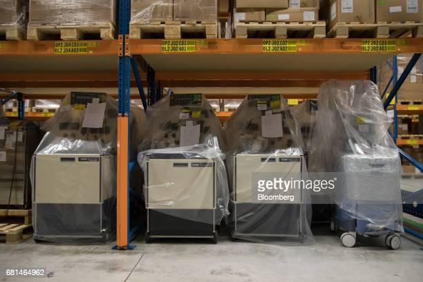 Apheresis apparatus manufactured Terumo BCT Inc stand beneath storage racks inside the Nippon Yusen KK pharma distribution center at the Port of...