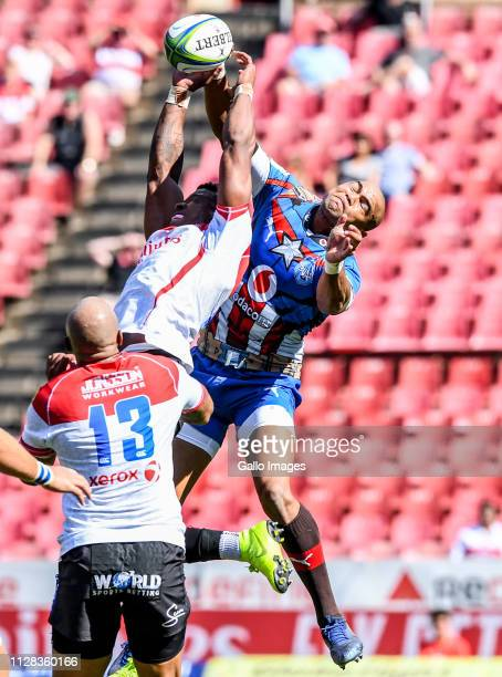 Aphiwe Dyantyi of the Lions and Cornal Hendricks of the Bulls in an arial battle for possession during the Super Rugby match between Emirates Lions...
