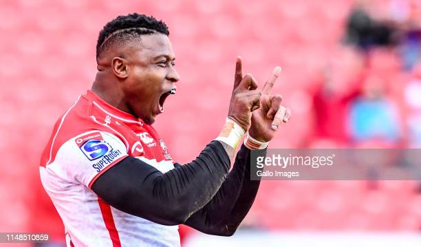 Aphiwe Dyantyi of the Lions celebrates after scoring a try during the Super Rugby match between Emirates Lions and Hurricanes at Emirates Airline...
