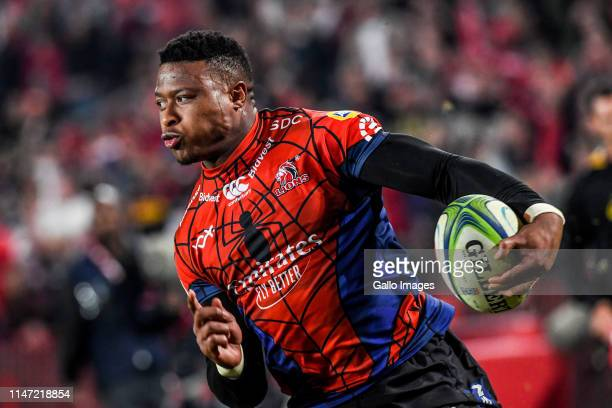 Aphiwe Dyantyi of the Lions reacts as he runs with the ball to score a try during the Super Rugby match between Emirates Lions and DHL Stormers at...