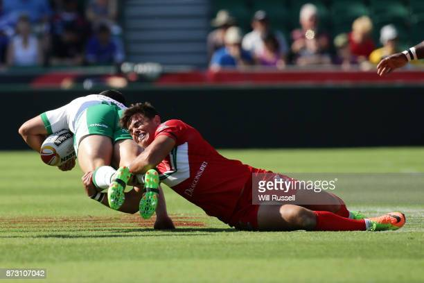 Api Pewhairangi of Ireland is tackled by Michael Channing of Wales during the 2017 Rugby League World Cup match between Wales and Ireland at nib...