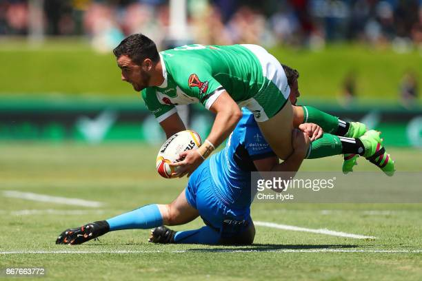 Api Pewhairangi of Ireland is tackled by Nathan Milone of Italy during the 2017 Rugby League World Cup match between Ireland and Italy at Barlow Park...