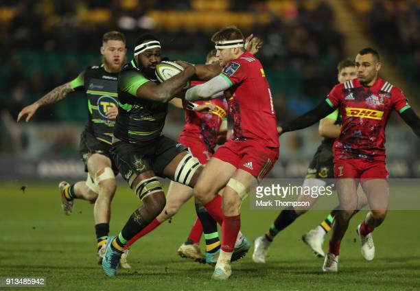 Api Ratuniyarawa of Northampton is tackled by Henry Cheeseman of Harlequins during the AngloWelsh Cup match between Northampton Saints and Harlequins...