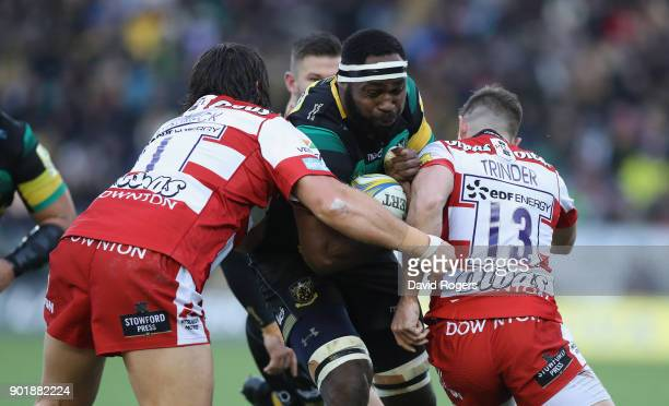 Api Ratuniyarawa of Northampton is tackled by Josh Hohneck and Henry Trinder during the Aviva Premiership match between Northampton Saints and...