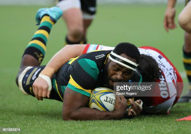 Api Ratuniyarawa of Northampton is tackled during the Aviva Premiership match between Northampton Saints and Gloucester Rugby at Franklin's Gardens...