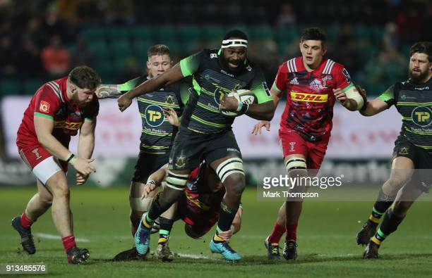Api Ratuniyarawa of Northampton Saints breaks through the Harlequins defence during the AngloWelsh Cup match between Northampton Saints and...