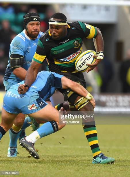 Api Ratuniyarawa of Northampton Saints is tackled by Alex Lewington of London Irish during the Aviva Premiership match between Northampton Saints and...