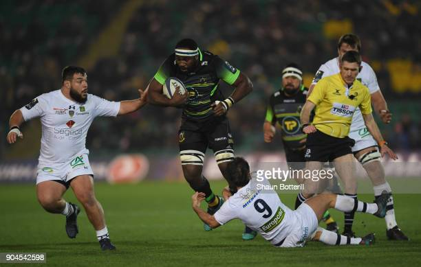 Api Ratuniyarawa of Northampton Saints is tackled by Morgan Parra and Rabah Slimani of Clermont Auvergne during the European Rugby Champions Cup...