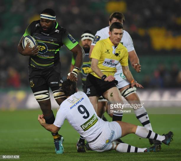 Api Ratuniyarawa of Northampton Saints is tackled by Morgan Parra of Clermont Auvergne during the European Rugby Champions Cup match between...