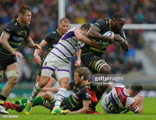 Api Ratuniyarawa of Northampton Saints tackled by Ben Youngs of Leicester Tigers during the Gallagher Premiership Rugby match between Northampton...