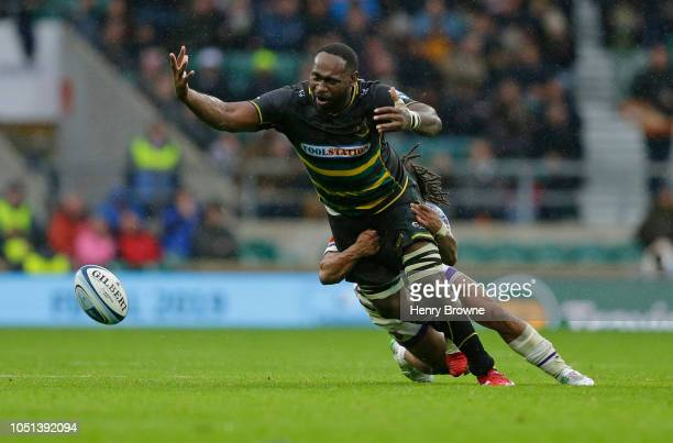 Api Ratuniyarawa of Northampton Saints tackled by Kyle Eastmond of Leicester Tigers during the Gallagher Premiership Rugby match between Northampton...