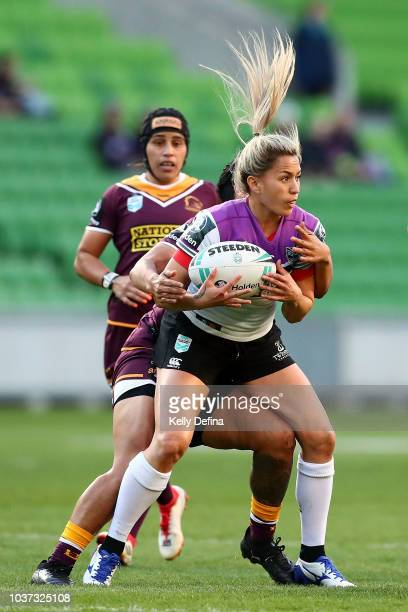 Apii Nicholls of the Warriors is is tackled during the round three NRLW match between the Brisbane Broncos and the New Zealand Warriors at AAMI Park...