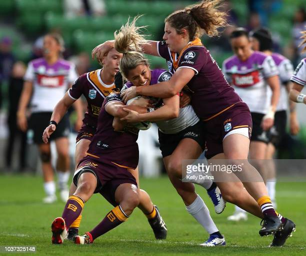 Apii Nicholls of the Warriors is tackled by the Broncos defence during the round three NRLW match between the Brisbane Broncos and the New Zealand...