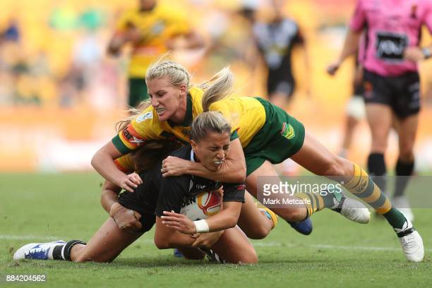 Apii NichollsPualau of the Ferns is tackled during the 2017 Rugby League Women's World Cup Final between Australia and New Zealand at Suncorp Stadium...