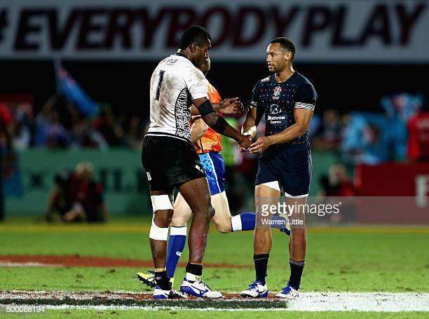 Apisai Domolailai of Fiji shakes hands with Dan Norton of England after the Cup Final during the Emirates Dubai Rugby Sevens HSBC World Rugby Sevens...