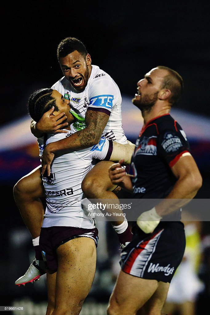Apisai Koroisau and Steve Matai of the Sea Eagles celebrate a try as Simon Mannering of the Warriors looks on during the round six NRL match between the New Zealand Warriors and the Manly Sea Eagles at Mt Smart Stadium on April 9, 2016 in Auckland, New Zealand.