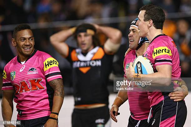 Apisai Koroisau Jamie Soward and David Simmons of the Panthers celebrate after Simmons scored a try during the round 16 NRL match between the Wests...