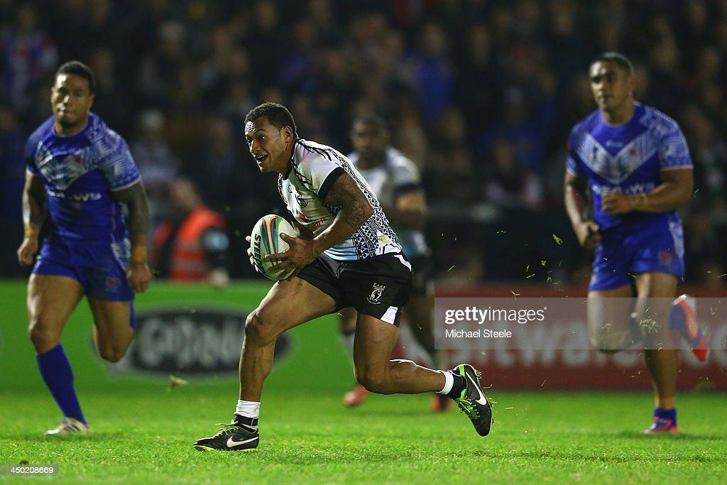 Apisai Koroisau of Fiji breaks clear during the Rugby League World Cup Quarter Final match between Samoa and Fiji at The Halliwell Jones Stadium on November 17, 2013 in Warrington, England.