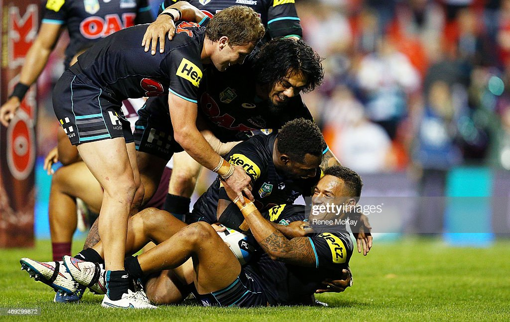 Apisai Koroisau of the Panthers celebrates his try with James Segeyaro; Sika Manu and Matt Moylan during the round six NRL match between the Penrith Panthers and the Manly Sea Eagles at Pepper Stadium on April 11, 2015 in Sydney, Australia.