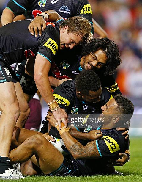 Apisai Koroisau of the Panthers celebrates his try with James Segeyaro Sika Manu and Matt Moylan during the round six NRL match between the Penrith...