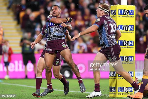 Apisai Koroisau of the Sea Eagles celebrates with team mates after scoring a try during the round ten NRL match between the Manly Sea Eagles and the...