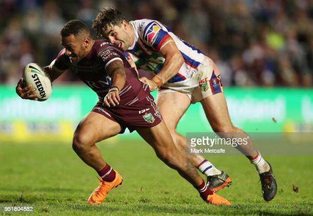Apisai Koroisau of the Sea Eagles is tackled by Aidan Guerra of the Knights during the Round eight NRL match between the ManlyWarringah Sea Eagles...