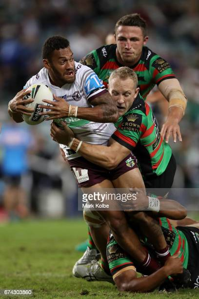 Apisai Koroisau of the Sea Eagles is tackled by Jason Clark of the Rabbitohs during the round nine NRL match between the South Sydney Rabbitohs and...