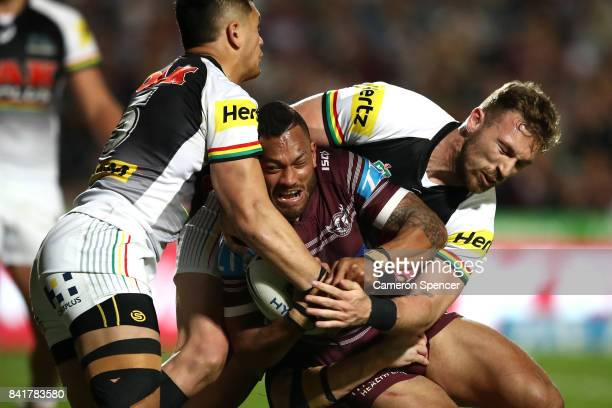 Apisai Koroisau of the Sea Eagles is tackled during the round 26 NRL match between the Manly Sea Eagles and the Penrith Panthers at Lottoland on...