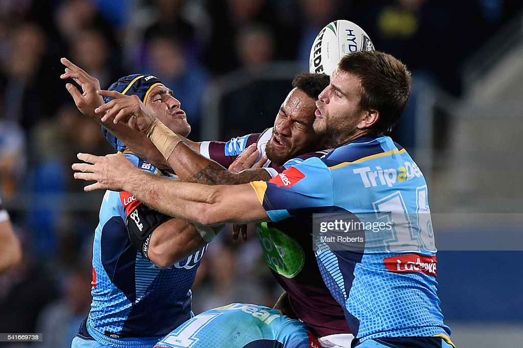 Apisai Koroisau of the Sea Eagles knocks on in the tackle during the round 15 NRL match between the Gold Coast Titans and the Manly Sea Eagles at Cbus Super Stadium on June 20, 2016 in Gold Coast, Australia.