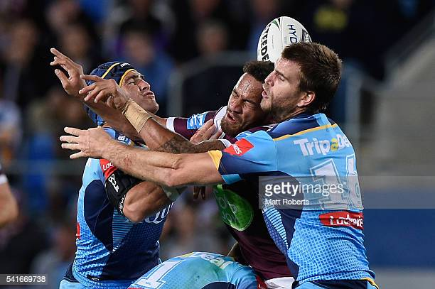 Apisai Koroisau of the Sea Eagles knocks on in the tackle during the round 15 NRL match between the Gold Coast Titans and the Manly Sea Eagles at...