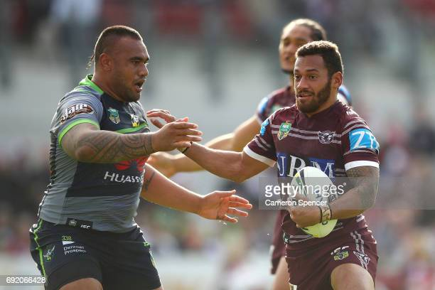 Apisai Koroisau of the Sea Eagles runs the ball during the round 13 NRL match between the Manly Sea Eagles and the Canberra Raiders at Lottoland on...