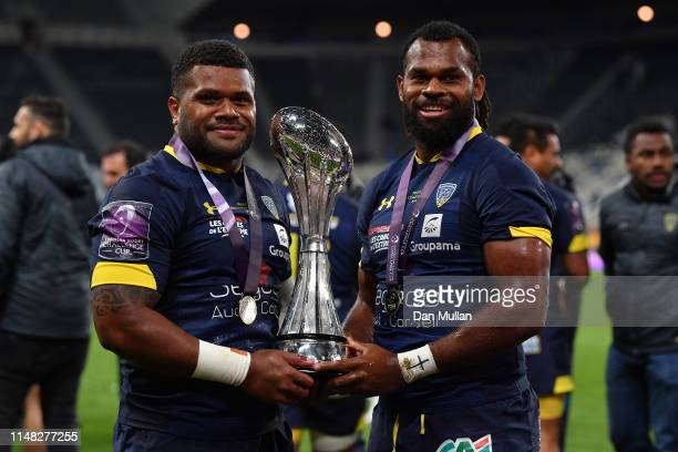 Apisai Naqalevu and Alivereti Raka of ASM Clermont Auvergne pose with the trophy after winning the Challenge Cup Final match between La Rochelle and...