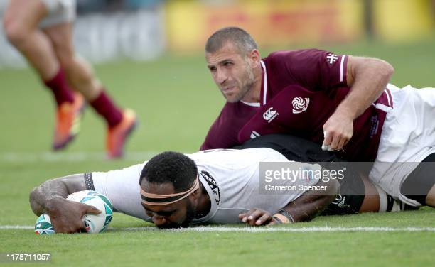 Apisalome Ratuniyarawa of Fiji scores his team's sixth try as he is tackled by Lasha Khmaladze of Georgia during the Rugby World Cup 2019 Group D...