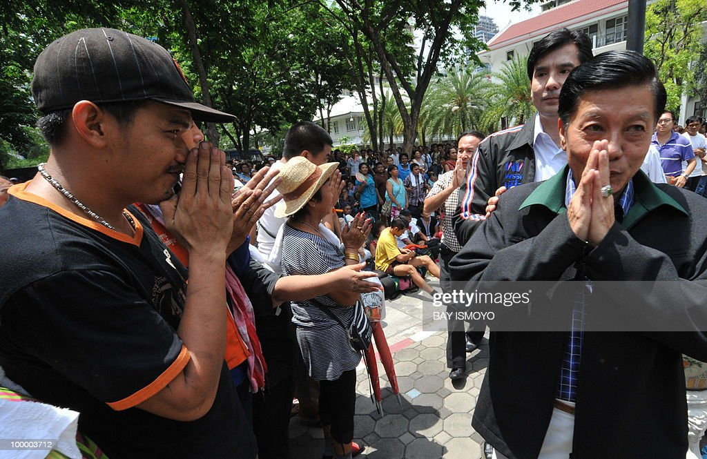 Apiwan Wiriyachai (R), the Thai deputy house speaker and member of the Puea Thai Party, Thailand's leading opposition party, meets anti-government 'Red Shirt' protesters at the police headquarters in downtown Bangkok on May 20, 2010. Thai police escorted thousands of protesters out of a Buddhist temple where they had cowered overnight after nine people were killed there in gunbattles. AFP PHOTO / Bay ISMOYO