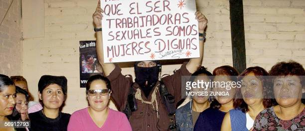 The Zapatista leader of the National Liberation Army Subcomandante Marcos poses with a group of female sexual workers during the rally of the other...