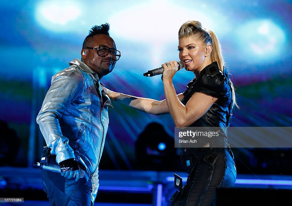 apl.de.ap and Fergie of the Black Eyed Peas perform onstage during CHASE Presents The Black Eyed Peas and Friends 'Concert 4 NYC' benefiting the Robin Hood Foundation at Central Park, Great Lawn on September 30, 2011 in New York City.