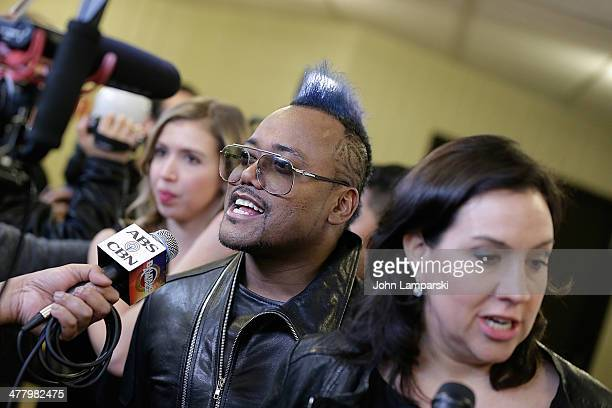 Apl.de.ap. And Kristen Anderson Lopez attend the Pinoy Relief Benefit concert at Madison Square Garden on March 11, 2014 in New York City.