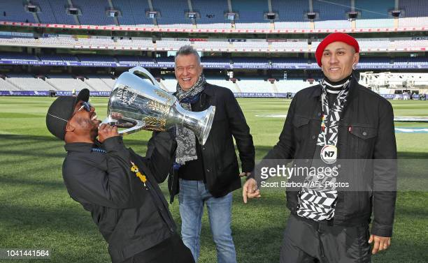 apldeap and Taboo of The Black Eyed Peas along with Jimmy Barnes pose with the 2018 AFL Premiership Cup during the AFL PreMatch Entertainment Press...
