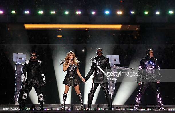 Apl.de.ap, Fergie, will.i.am and Taboo of the Black Eyed Peas perform during the Bridgestone Super Bowl XLV Halftime Show at Cowboys Stadium on...