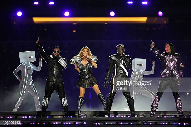 apldeap Fergie william and Taboo of the Black Eyed Peas perform during the Bridgestone Super Bowl XLV Halftime Show at Cowboys Stadium on February 6...