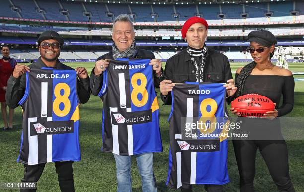 apldeap Jessica Reynoso and Taboo of The Black Eyed Peas along with Jimmy Barnes pose during the AFL PreMatch Entertainment Press Conference at...