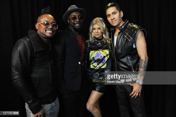 apldeap william Fergie and Taboo of The Black Eyed Peas pose backstage at CHASE Presents The Black Eyed Peas and Friends Concert 4 NYC benefiting the...