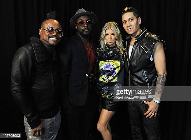 apldeap william Fergie and Taboo of The Black Eyed Peas pose backstage at CHASE Presents The Black Eyed Peas and Friends 'Concert 4 NYC' benefiting...