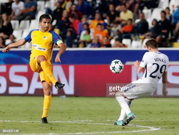 Apoel FC's Portuguese midfielder Nuno Morais has his pass blocked by Tottenham Hotspur's English midfielder Harry Winks during the UEFA Champions...